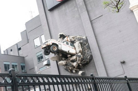30627435 - a decorative car crashed into the building