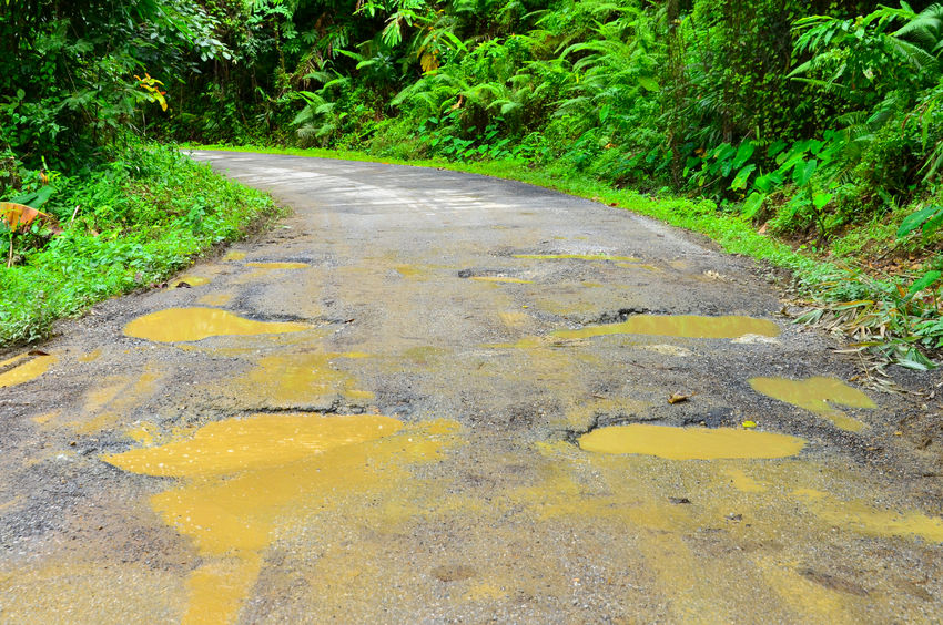 22585223 - damaged asphalt pavement road and potholes.